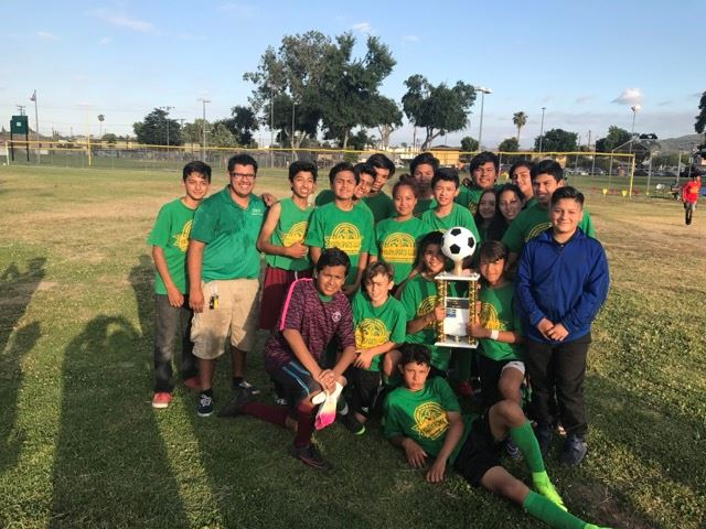 Co-Ed Soccer Team Holds Trophy