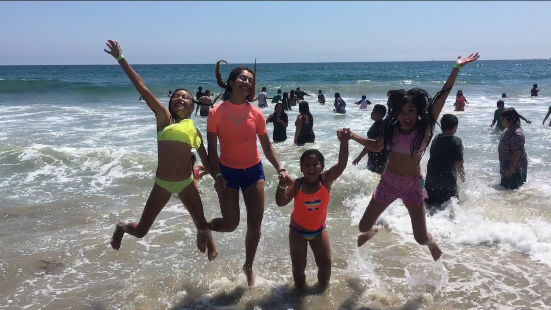 Kids and leader enjoying time at the beach